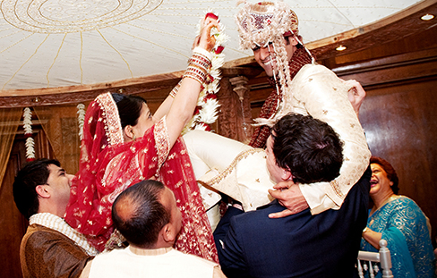 A photograph shows a bride and groom in a wedding ceremony.
