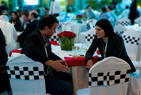 A photograph shows two people making eye contact during a conversation.c